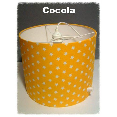 Baby en kinderkamer hanglamp van gele sterren stof .Hoog 25 cm en de omtrek 30. Merk Cocola.