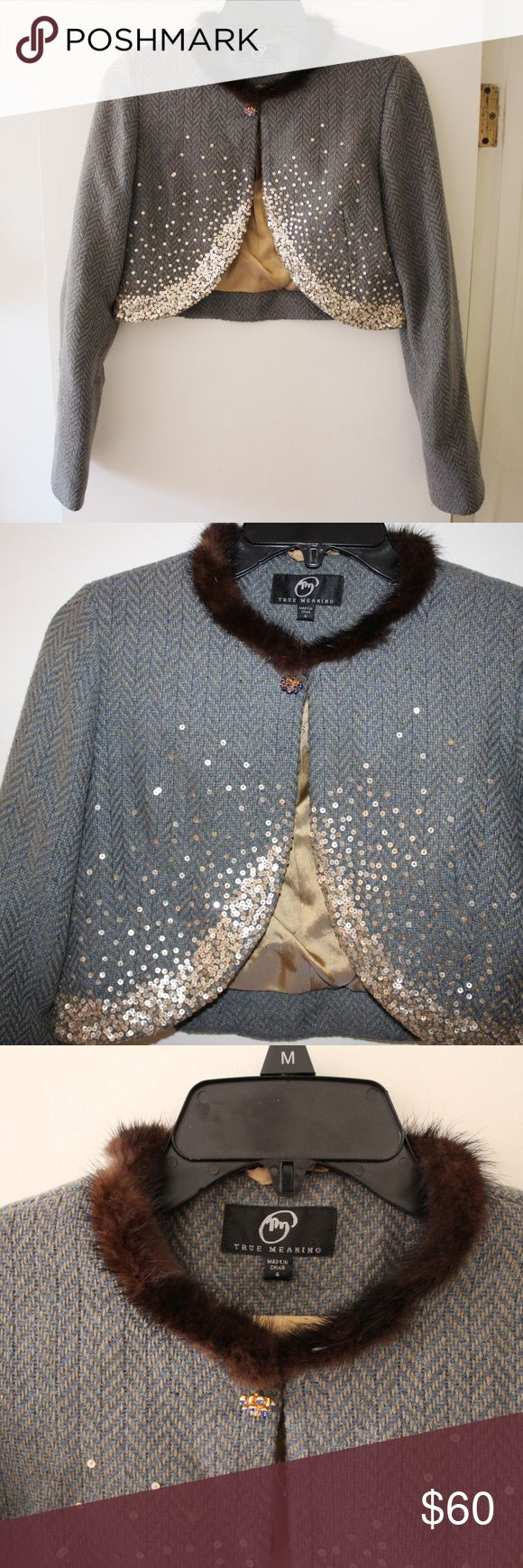 "TRUE MEANING Crop Wool Embellished Jacket Sz 4  S TRUE MEANING Crop Embellished Jacket  Brand new without tag - never used - perfect condition  Poly, wool, acrylic blend.  GORGEOUS!!  Kinda sad to sell this but unfortunately doesn't fit - so enjoy!  Gold sequins and I think the fur around the neck is rabbit..it's super soft and fluffy.  Buttons at the neck with a pretty blue rhinestone broach that is attached to jacket.  Length:  16"" Shoulder to wrist:  24"" True Meaning Jackets & Coats"