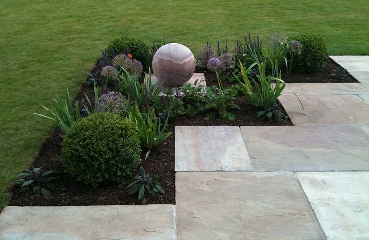Newly created planting bed on the corner of the redesigned patio - with a self-contained 'Foras' sandstone sphere water feature; a very safe choice for a family garden