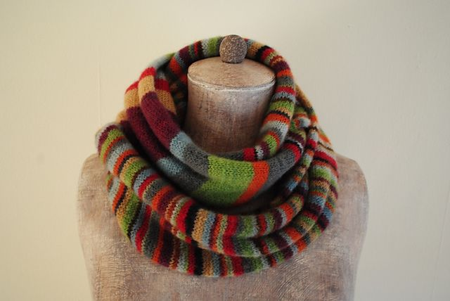 A colourful infinity scarf with matching knee warmers
