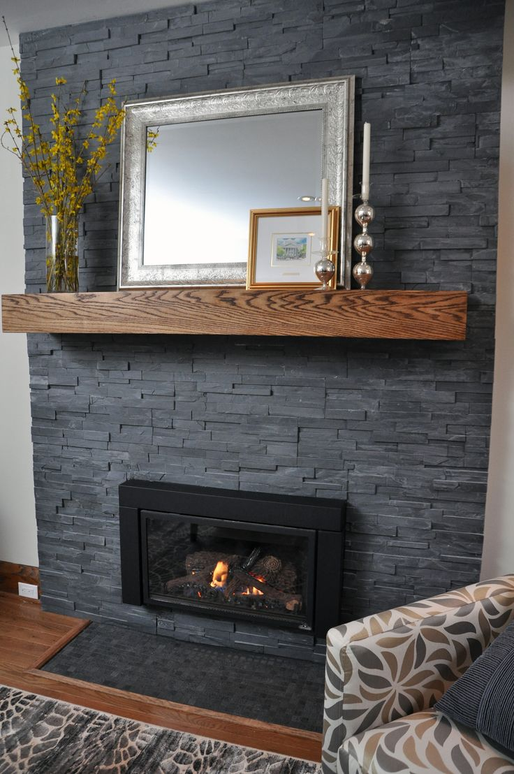 Living Room Fireplace Clad In ErthCOVERINGS Springwood Black Series Natural Stone Veneer
