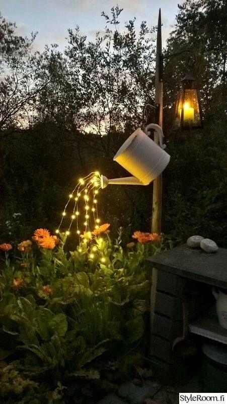 Outdoor Lighting This is such a cute idea! I have already done the watering can in my garden in the past, maybe I will add lights this year!
