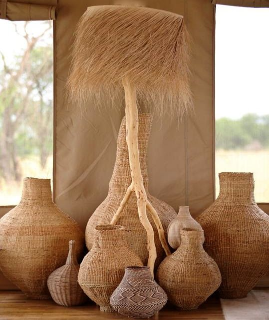 Africa | Basketry | Large and extra-large contemporary Xhosa-weave gourds from South Africa, with a BaTonga nongo basket from Zimbabwe in the foreground.