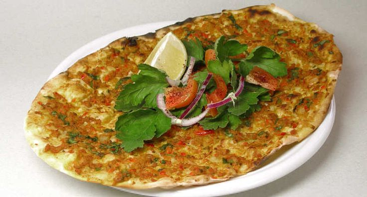 Lahmacun - Flat Bread with Lamb and Tomatoes - Turkish Lahmacun is a baked flatbread topped with minced meat, onions, tomatoes, peppers and spices served with a side of parsley and a lemon wedge that add a hint of freshness. Try baking these Turkish spiced lamb and tomato flat breads on a heated pizza stone in the oven so that the crust and topping cook evenly.  - http://aussietaste.recipes/pizza/lahmacun-flat-bread-with-lamb-and-tomatoes/  -   #recipe