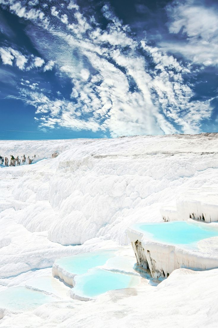 """Pamukkale, meaning """"cotton castle"""" in Turkish is a natural site in southwestern Turkey that has existed for thousands of years. Click through to see 20 more UNREAL Travel Destinations!!"""