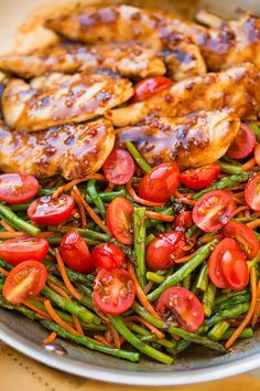 One Pan Balsamic Chicken And Veggies - Italian salad dressing - balsamic vinegar - honey - crushed red pepper flakes - chicken - olive oil - asparagus or green beans - carrots - grape tomatoes - Cooking Classy