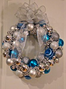 DIY Christmas Ornament wreath - I like the cheapo mardi gras beads to cover the gaps (because I suck at making things line up prefectly)