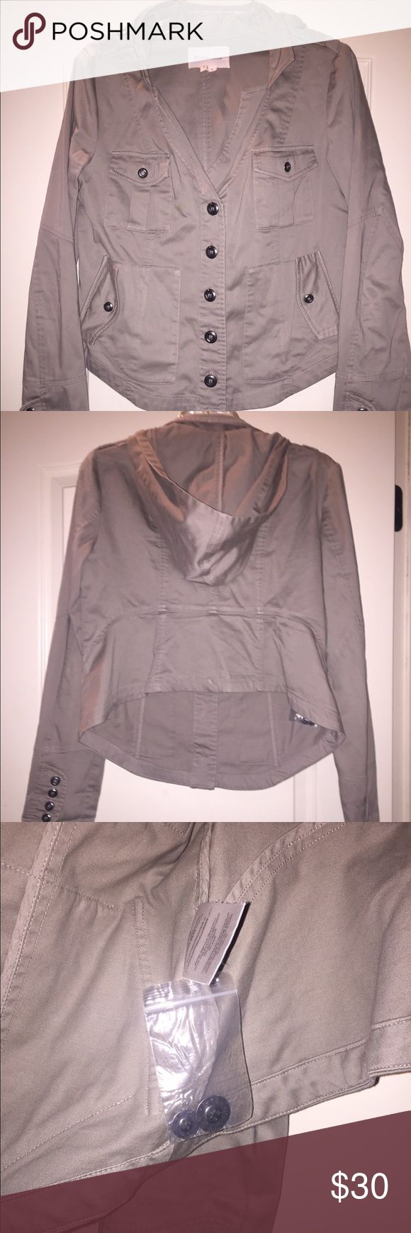 BCBGeneration Military Style Jacket w/hood Khaki colored military style jacket with hoodie that can be hidden in a zipper pocket.  The retail tag is missing, but the tag with the replacement buttons is attached. BCBGeneration Jackets & Coats Utility Jackets