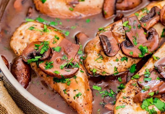 Chicken Madeira - tender chicken breasts in a rich peppery Madeira sauce with mushrooms and served over mashed potatoes.