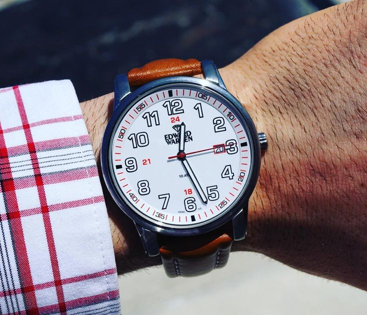 Today's #watchwednesday is a EWJ signature in stainless steel, light brown leather, and sharp red accents. Price: $210.00