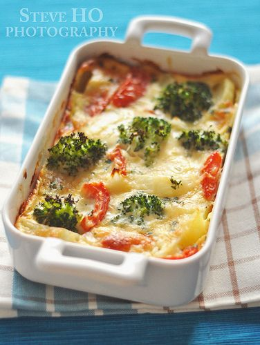 vegetable clafoutis with broccoli, tomato, onion and cheese