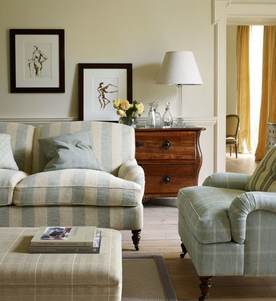 the best sofa to buy | laurel bern's #1 pick! | decorating help in NY | beautiful living room and design. Love the English roll arm sofa and chair and fabric by Colefax and Fowler | beautiful pale colors | light blue with neutrals | pop of black | Antique chest | traditional living room