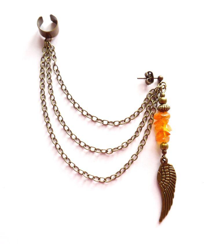Ear cuff i brons med kedjor och bärnsten.