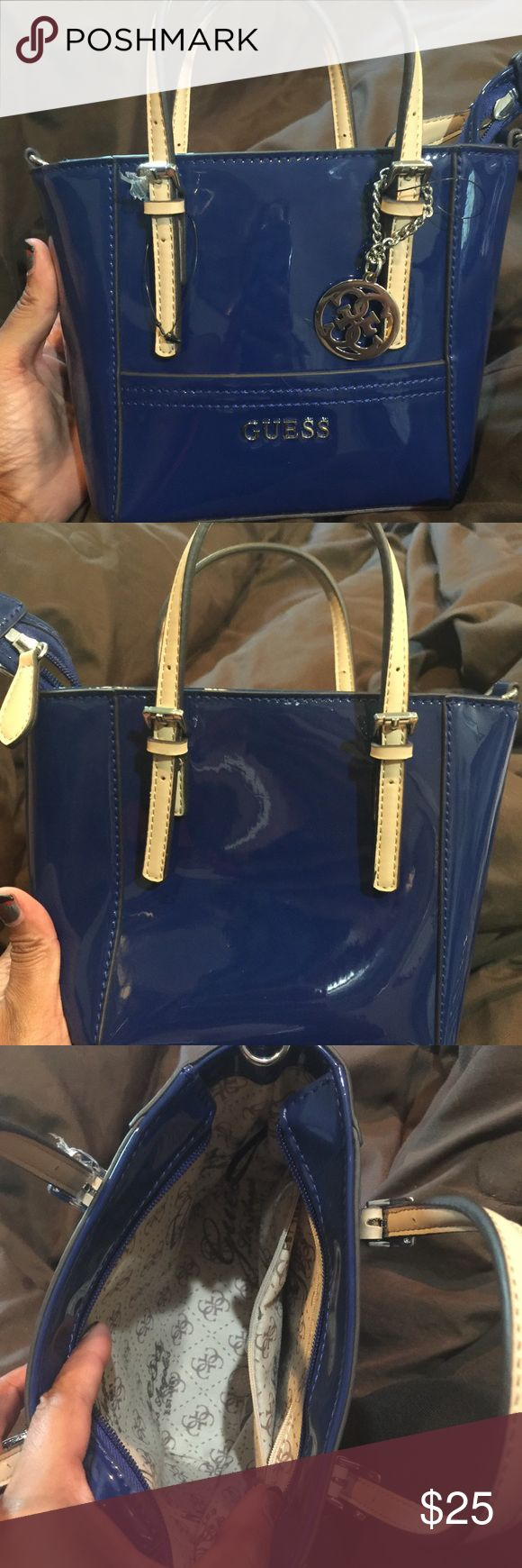 NWOT. NEVER USED. Authentic blue GUESS purse Guess purse New As shown No trades Instagram.com/stormyxstorm GUESS Bags