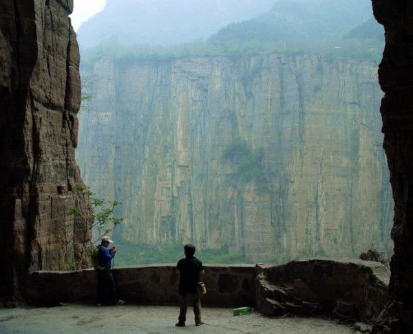 "The Guoliang Tunnel: One of the World's Scariest Roads Looking out through one of the larger ""windows"" which were originally used to dispose of rubble. http://www.visiontimes.com/2015/03/04/the-guoliang-tunnel-one-of-the-worlds-scariest-roads-pics-videos.html"