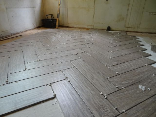(via Danny Seo) Shaw Floors (ceramic tile that looks like petrified wood) laid in herringbone... made in the USA and eco friendly