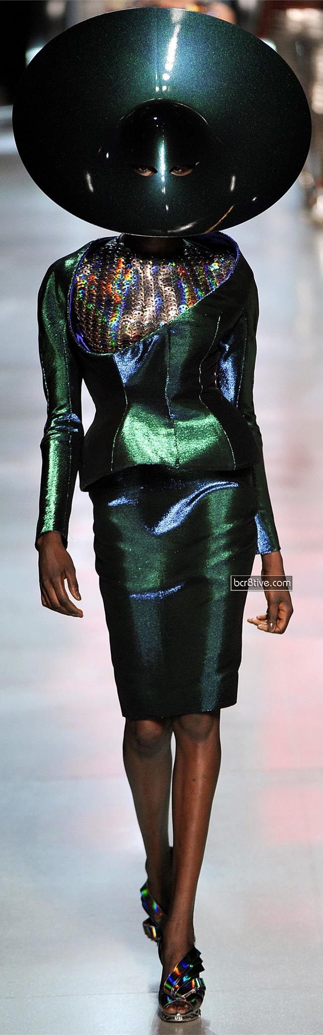 Manish Arora for Paco Rabanne SS 2012 On the plus side - I imagine her  head gets pretty good reception!  ;-)