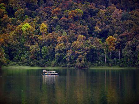 Lonely boat in Situ Patengan Photo by Irawan Subingar — National Geographic Your Shot
