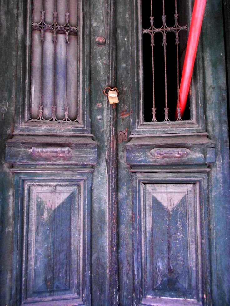 "Door ""impaled"" by red pole, behind blue tarp Doors of Exarcheia series, Athens, 2015"