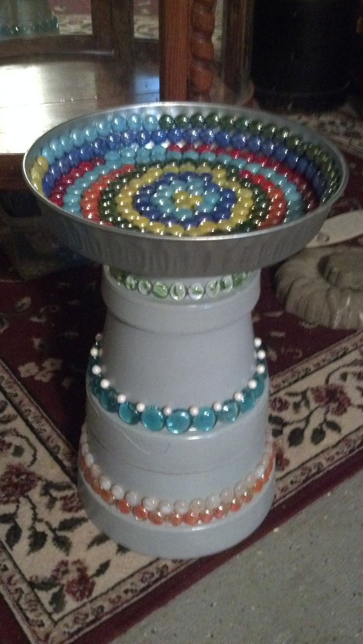 bird bath make from clay pots, paint and marbles