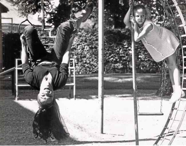 Eartha Kitt with daughter Kitt playing in the backyard. Mother and daughter had a home in Beverly Hills and in London.