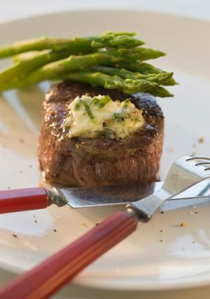 Make a Decadent Compound Butter to Top Your Favorite Steak: Grilled steak with herb butter.