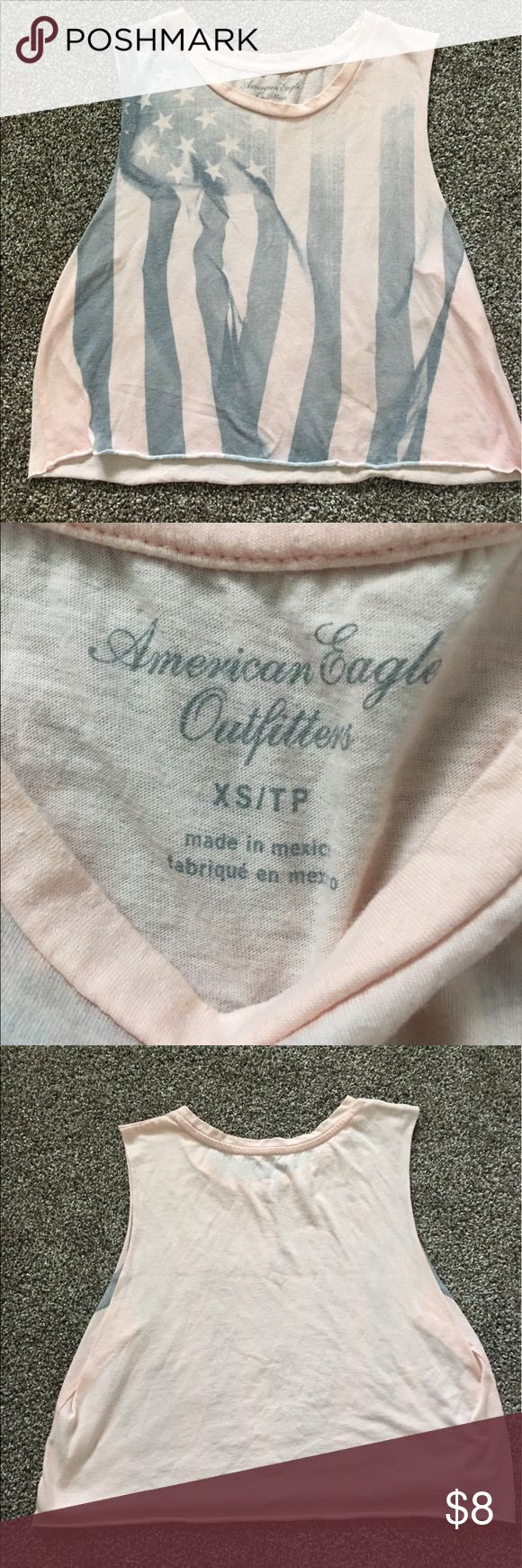 American Eagle Crop Top Selling this light pink crop top from American Eagle. Has a faded American flag on the front. Size extra small. American Eagle Outfitters Tops Crop Tops