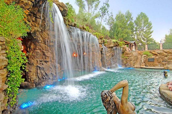 A luxurious pool with a waterfall and a cave at old lion for Pool design waterfall