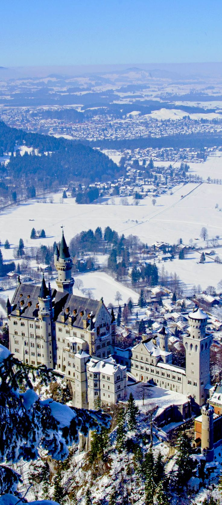 Neuschwanstein castle in Bavarian Alps, Germany    |   The 20 Most Stunning Fairytale Castles in Winter