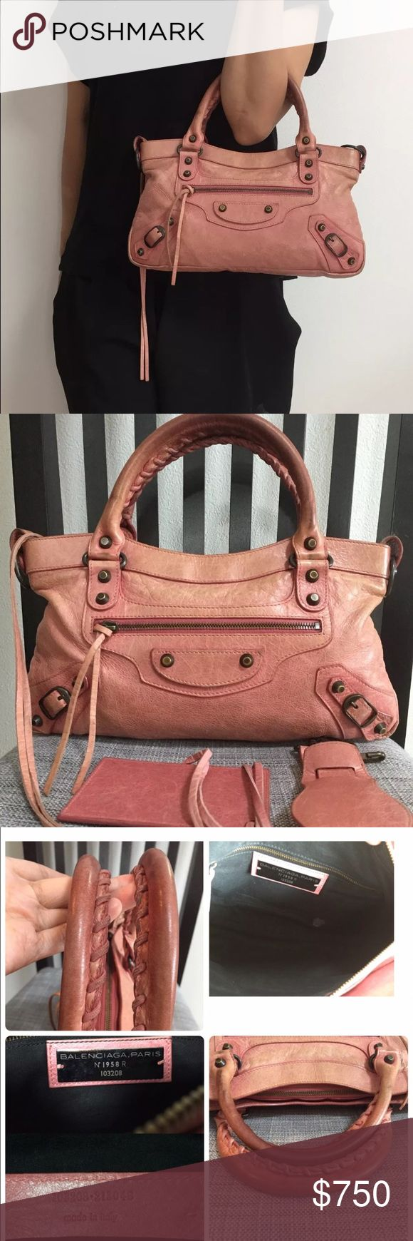 Balenciaga The First handbag Authentic 09 Pink Balenciaga The first Handbag. This item has been preloved please check the photos before submitting an offer or purchasing. There is normal wear on the bag from normal use. It comes with mirror and removable strap. No dust bag is included. Balenciaga Bags