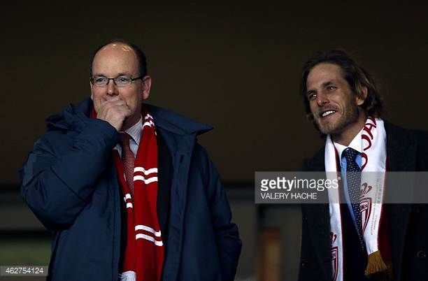 Prince Albert II of Monaco and his nephew Andrea Casiraghi attend the French League Cup quarterfinal football match between Monaco and Bastia on...