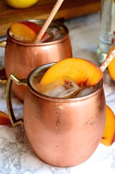 Try this easy end-of-summer Ginger Peach Moscow Mule cocktail recipe featuring spicy fresh ginger, sweet ripe peaches, and @SmirnoffUS #AD