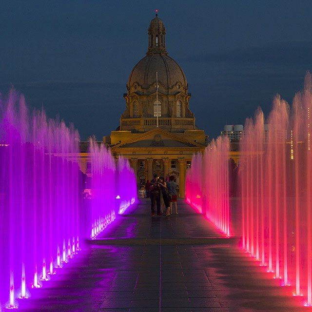 People enjoy the 100 new coloured fountains in front of the newly-renovated Federal Building on the legislature grounds on July 14, 2015, in Edmonton. Photo by Greg Southam / Edmonton Journal #yeg #edmonton #capitalcity #alberta #legislature #summer #fountains