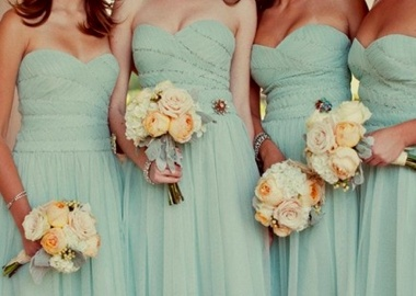 mint strapless dresses matched to peach and sage green bouquets