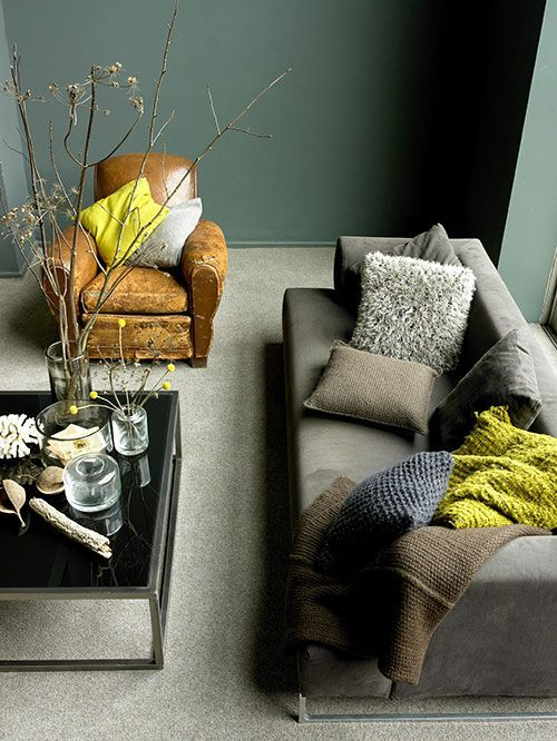 peaceful grey room with a green wall and lime accents