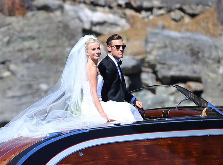 <p>Hough sports a smile as her soon-to-be husband stays behind the wheel. </p>
