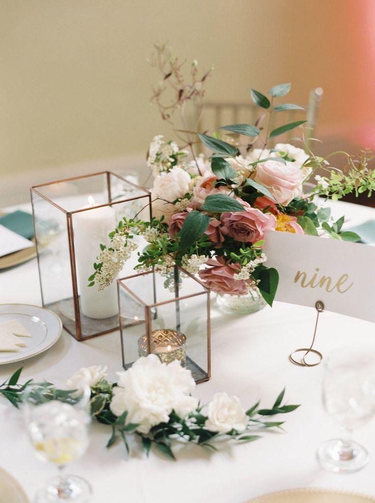 Romantic wedding centerpieces, pink floral arrangements, indoor wedding reception, glass boxes with candles, gold and white table numbers, pin to your own wedding reception inspiration board // Alicia Ann Photographers