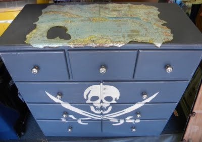 I could paint Emmets dresser to match his color scheme I've got going. I won't do the skulls and swords but I am thinking a pirate ship??