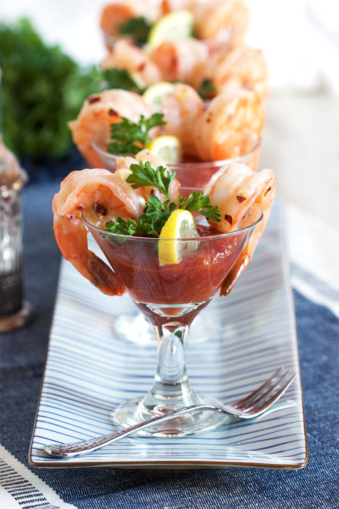 Ready in minutes, this tasty twist on shrimp cocktail will be a staple at any party. Garlic Roasted Shrimp Cocktail recipe is easy and quick. Bursting with vibrant flavor. | @suburbansoapbox