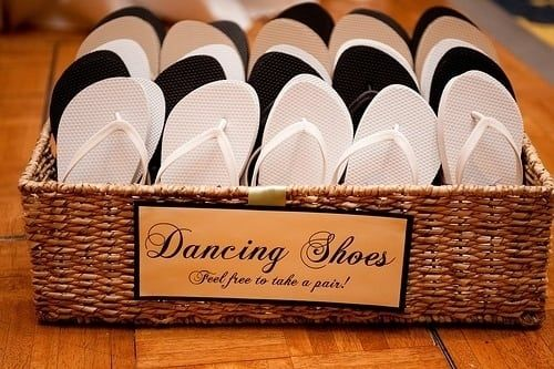 'Let's go and dance!''I can't, my heels are killing me.'Say goodbye to that excuse by offering your guests comfy dancing shoes (okay, they're just flip flops) as they join you in dancing the night away!