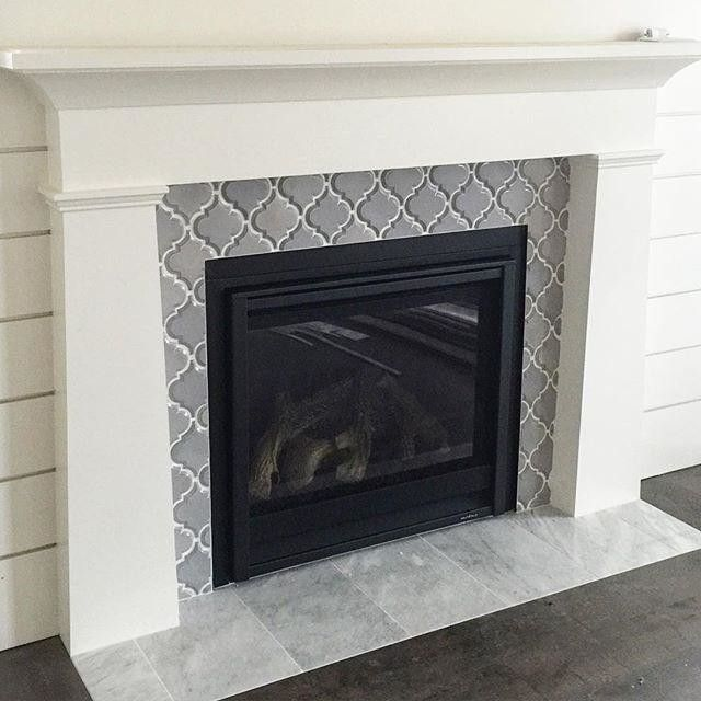 Artisan Arabesque Grigio Ceramic Wall Tile fireplace surround with a marble hearth. #arabesquetile #fireplace #thetileshop #marbletile