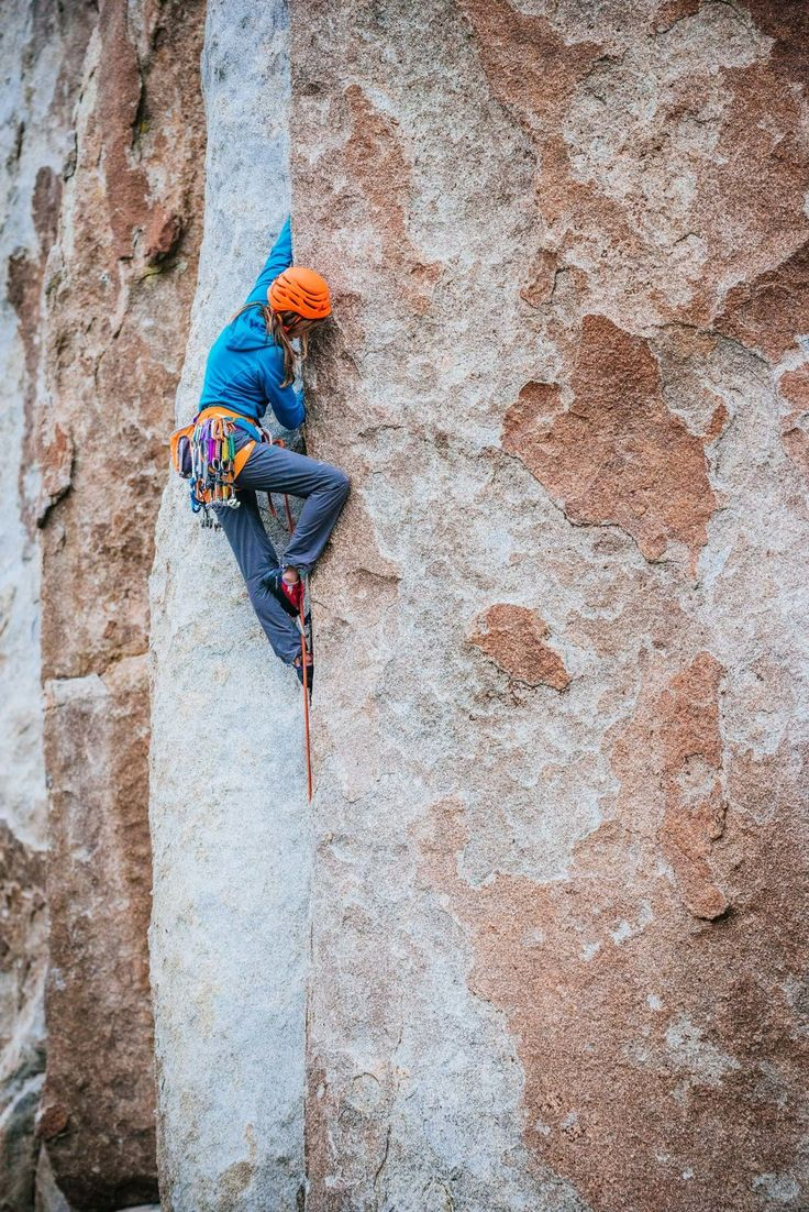 "Heather ""squirming"" her way up the finger crack on ""Crack of Doom"" (5.11b)."