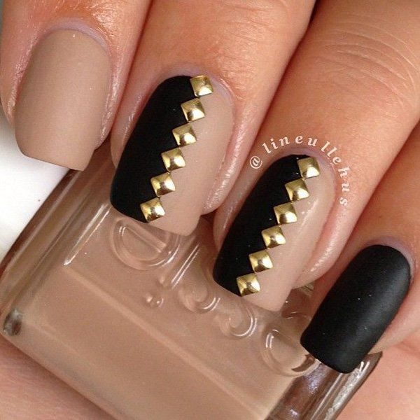 Check out this amazing black, nude and gold painted nail art design that is both elegant and classy.