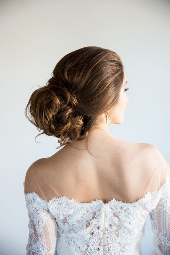 Romantic Messy Updo Bridal Hairstyle with a Loose Bun and Off the Shoulder Wedding Dress heyweddinglady.co... #ultraviolet#pantone#wedding#weddings#weddinginspiration#weddingfashion#bridalstyle#weddingtrends#purpleweddings#purple#glamweddings #hairstyle #weddinghair #Bridalhair