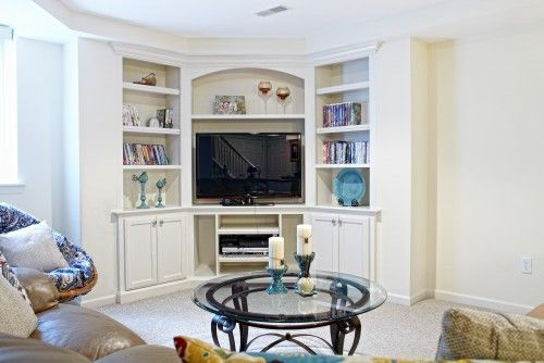basement remodel idea...like the use of the corner built-ins