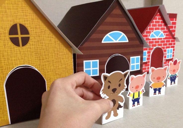 Arte para imprimir, montar e brincar! <br> <br>Três casinhas: madeira, palha e tijolos, os 3 porquinhos e um lobo mau quase assustador!