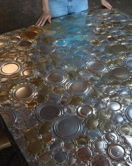 The Art Of Up-Cycling tin can lids and bottoms.. made into a table.. but I would love to see back splash or ceiling in a kitchen!