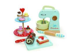 Le Toy Van wooden mixer set and cake stand.(sold separately). The cake stand comes with assorted little cakes. The mixer set has mixer, rolling pin, tray, assorted cakes and a knife that cuts the pre cut cakes. AGE:  2+#toys2learn#letoyvan#honeybake #cake#stand#wooden#mixer#set#cook #cooking#kitchen#pretendplay#play#toys #toy #children #child #kids
