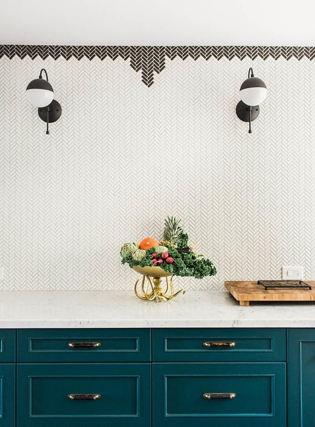 Parisian/Moroccan inspired kitchen - mini herringbone tile backsplash, colorful cabinetry