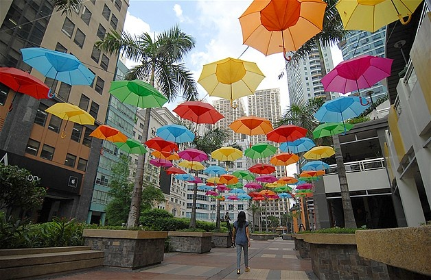 June 10, 2013: A woman walks under an array of colorful parasols adorning Eastwood Park in Quezon City, Philippines, on June 7.